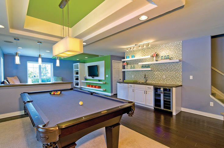 Colorful Basement For The Whole Family With Pool Table