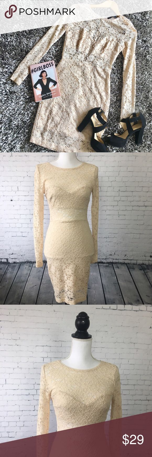"""Foreign Exchange Lace Bodycon Dress Sexy and sweet lace bodycon dress from Foreign Exchange. Warm cream color with contrasting black zipper. Sheer on the sleeves and midsection for a little peek-a-boo style. Wear with black heels and your favorite bag for a night out. Nylon, spared and polyester. Size M. Approx 36"""" long. Excellent condition. Foreign Exchange Dresses Long Sleeve"""