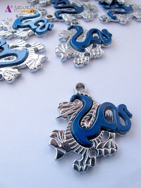 Blue and silver dragon dragon pendants blue by APlusJewelryCrafts $6.30 Blue and silver, dragon, dragon pendants, blue and silver, blue dragon, chinese dragon, asian dragon, jewelry supplies, fun
