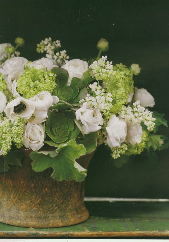 ~Lovely white and shades of green floral arrangement.