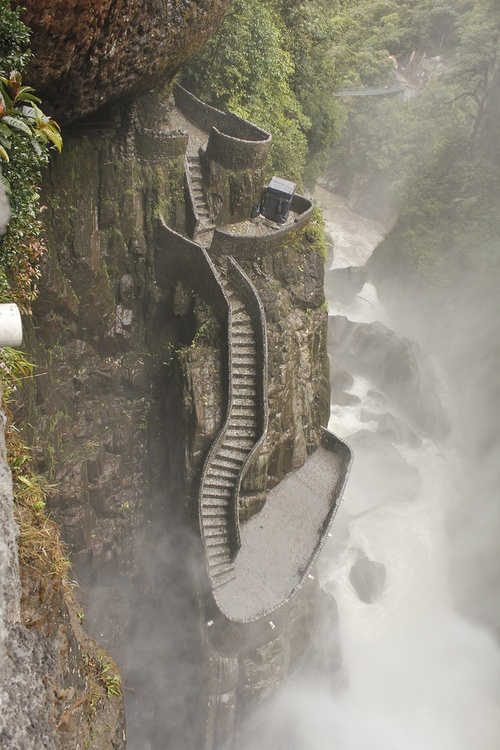 """Mountain side waterfall staircase at Pailón del Diablo waterfall in Cuenca, Ecuador. The path to Paílón del Diablo is a fairly large waterfall (located on the Pastaza River) just 30 minutes away from the town of Baños in Ecuador.   It is considered to be one of the most popular attractions in the area. The name of the waterfall in Spanish (Paílón del Diablo) means in English """"Cauldron of the Devil""""."""