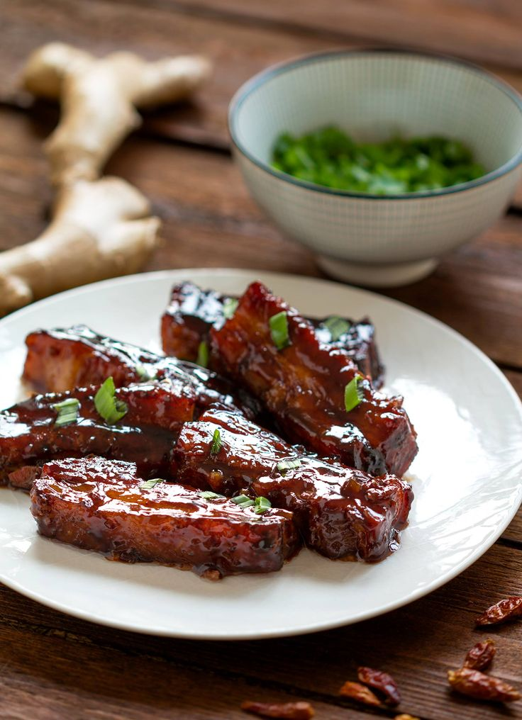 Sticky Asian glaze gives pork belly deep rich flavour. Add chives to give freshness to the dish.