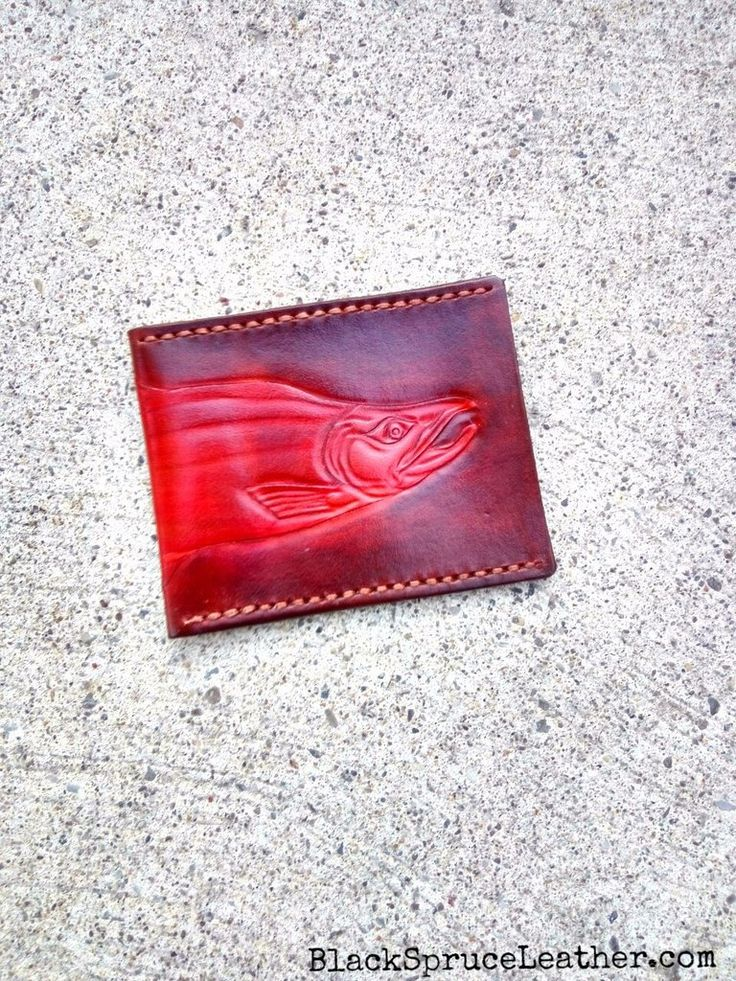 The Slim: Simplistic front pockets wallet. Fits in front pocket and has two seperate slots for cards / cash. Handmade: Hand carved, hand sewn, one of a kind.