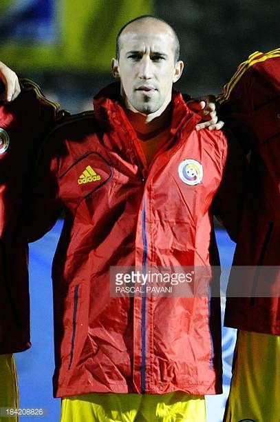 Romania's midfielder Iasmin Latovlevici listens to the state anthem before the FIFA 2014 World Cup qualifying Group D football match Andorra vs...