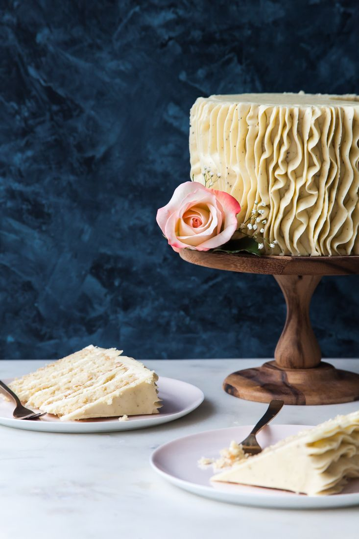 Layers of fluffy white cake are smothered in vanilla-flecked, Earl Grey infused buttercream before being engulfed in delicate crepe ruffles (gluten-free)