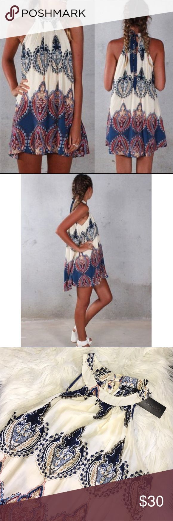 """NWT Boho Sleeveless Print Mini Sun Dress Cover Up Light airy Boho dress is new with tags.  Ties at neck in back.  Sleeveless.   Pull on.  Actual item pictured after pics #1 & 2.   Stock photos show fit.   Tag size XL but fits more like Large.   Approx:  pit to pit laying flat 21.5"""",  length 32"""".  100% rayon. ZG&DD Dresses Mini"""