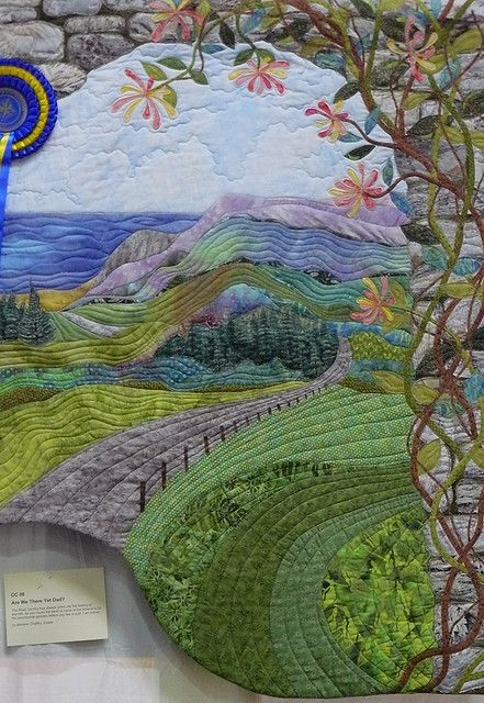 Quilted landscape This quilted wallhanging, demonstrates how careful choice of colour and applying the rules followed in photography can produced a work of art, which many would be happy to capture as a photography. Very slight cropping to straighten the lopsided hanging, and enhancement of hue and saturation to recreate the colours which were slightly washed out under the lighting.