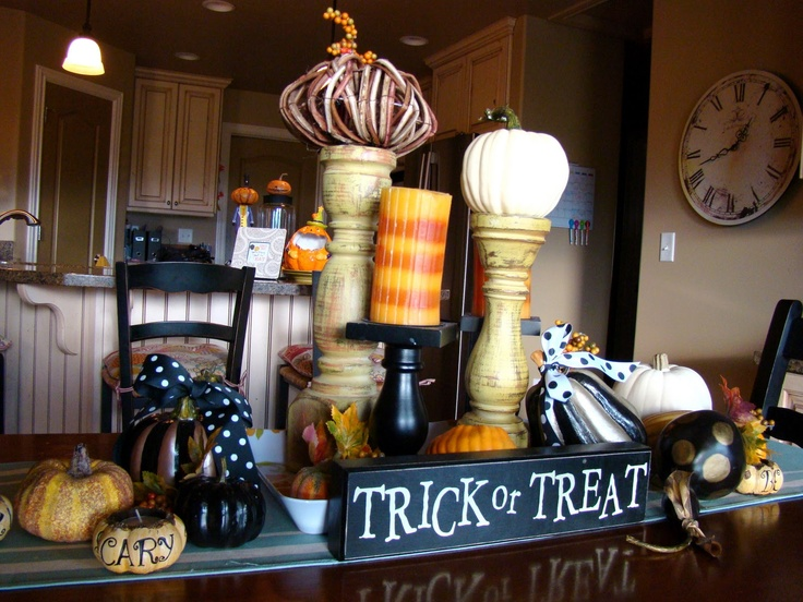 Halloween decor- don't forget to use candle sticks with pumpkins. Easy and cheap