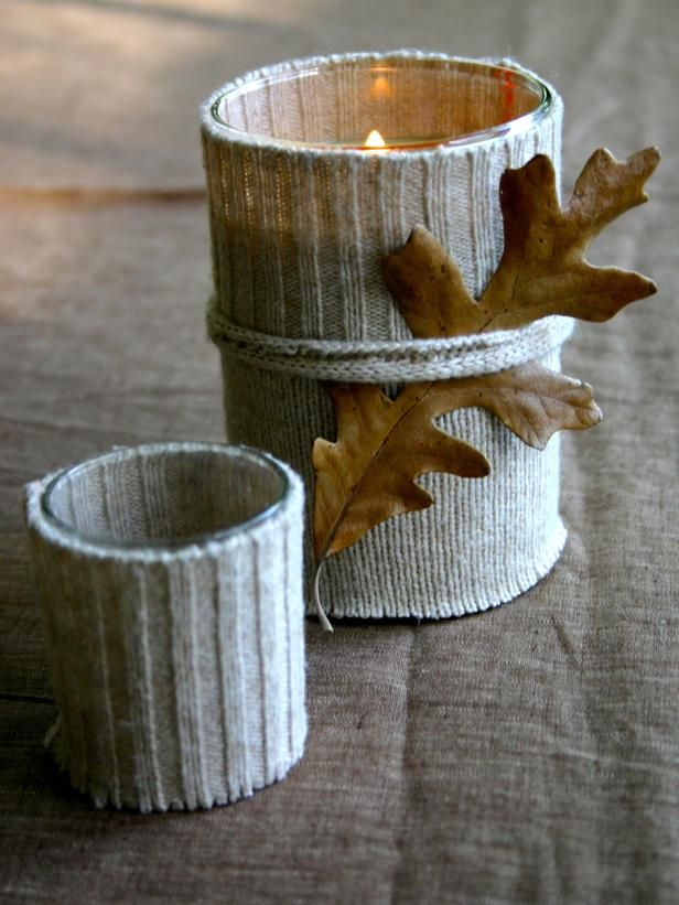 I love different textures when it comes to decorating. What a great way to bring in the fall with knit covered glass candle holders.  Imagine what you could do with old knit sweaters, in different colors, for making a unique fall centerpiece.  Add some acorns, fall leaves, and pine cones..... voila!!!!!