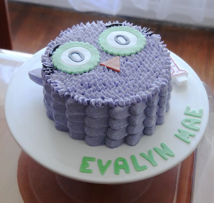Evalyn's First Birthday Cake, PHOTO 1 of 2 using the DIY Gray Owl Cake Decorating Tutorial as a guide. I used the Spoon method for the sides. The colours weren't what I intended LOL Still turned out pretty good.