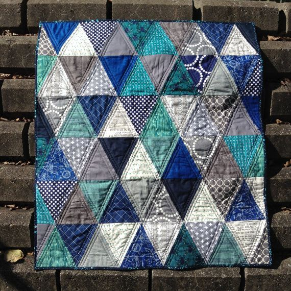 Bright fun triangle baby quilt by LethargicLass on Etsy