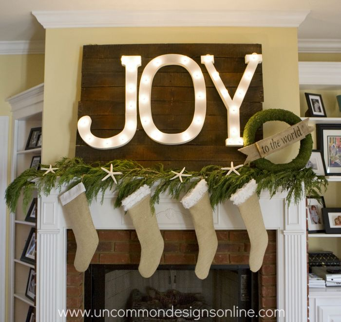 Joy to the World Mantel... lit marquee letters, burlap stockings, star fish, and a moss wreath... a perfect combo for a stunning Christmas display!