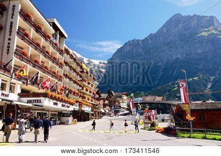 #GRINDELWALD, #SWITZERLAND - #Hotel Kreuz & Post; #Mountains in the Background. Grindelwald is a #Mountain Ski #Resort Village in #Jungfrau Region. #stockimages