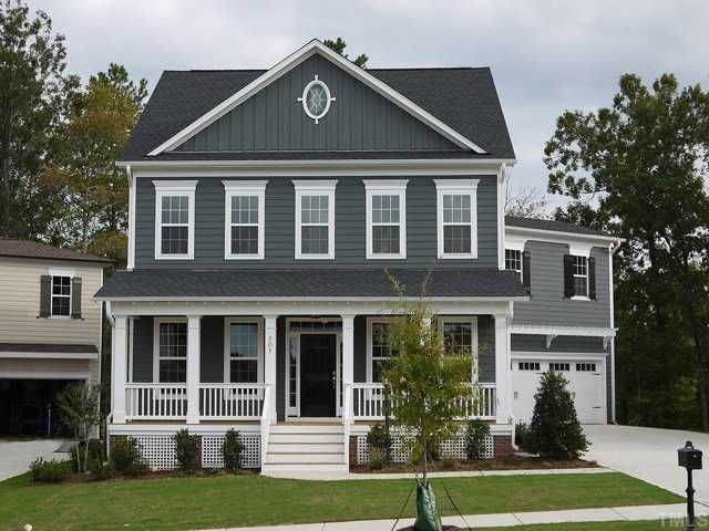 Grey blue new home exterior color white trim is a must for Blue house builders