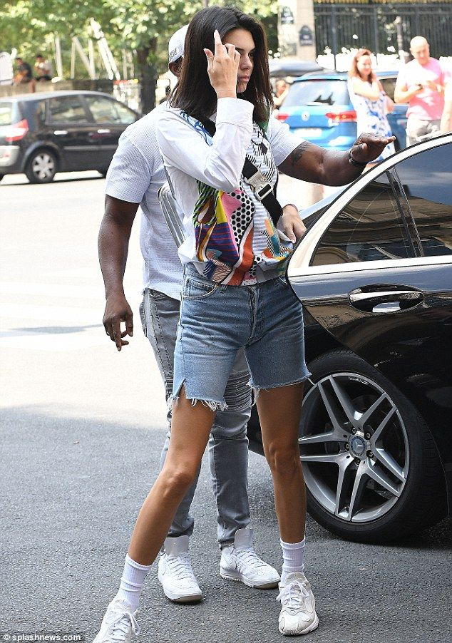 Kendall Jenner looks casual chic in colorful blouse and cut-off shorts