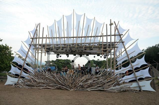 Boom Festival designers create really cool eco-friendly bioconstruction designs. This gallery shows what it looks like during the day  at night.