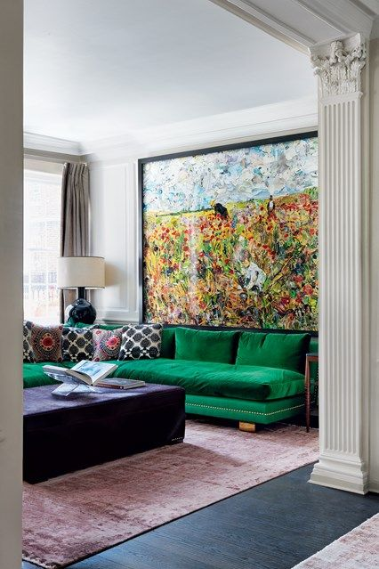 A green corner sofa in the sitting room of a Chelsea house designed by Freddy van Zevenbergen. Living Room Ideas and Designs