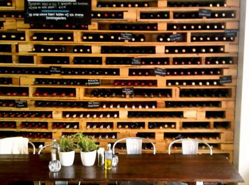 Pallet Outdoor Furniture | Pallets stacked up and secured into the wall to create a vast storage ...
