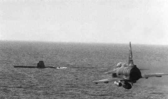 Swedish armed forces, a Saab Viggen simulates an attack against a Draken-class submarine.