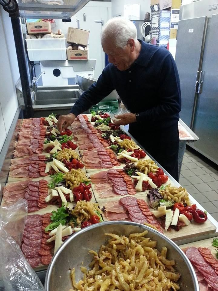 Tony laying out antipasto boards