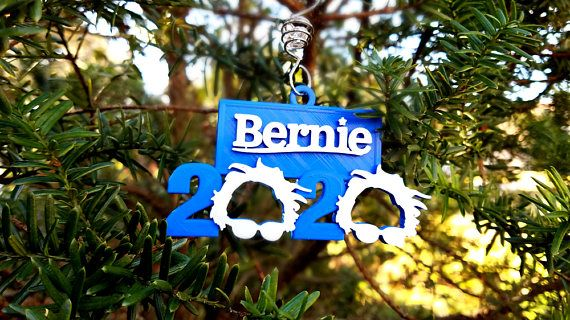 "Bernie Sanders 2020 Holiday Ornament  Show your support for Bernie with this hopeful ornament!  3D printed from PLA biodegradable plastic.   Dimensions w: 4"" x h: 2 3/8"" x d: 1/8""  ******Tree hanger not included.******  #berniesanders #Democracy #resist #christmas #ornament #holidays #etsy #etsyseller #EtsyShop"