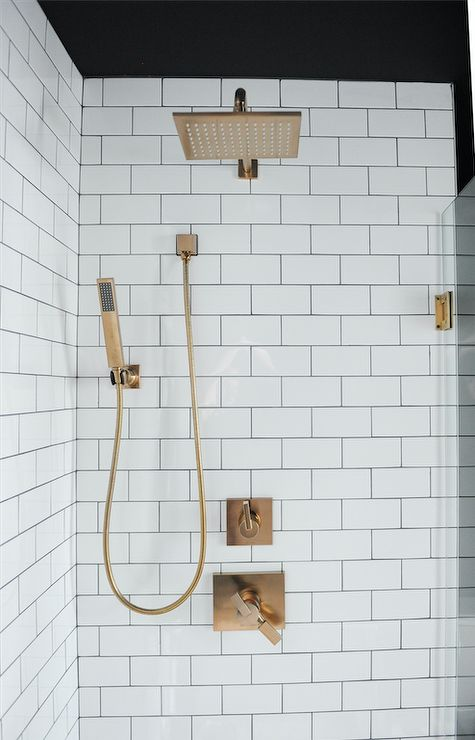 Contemporary walk-in shower features a square bras…