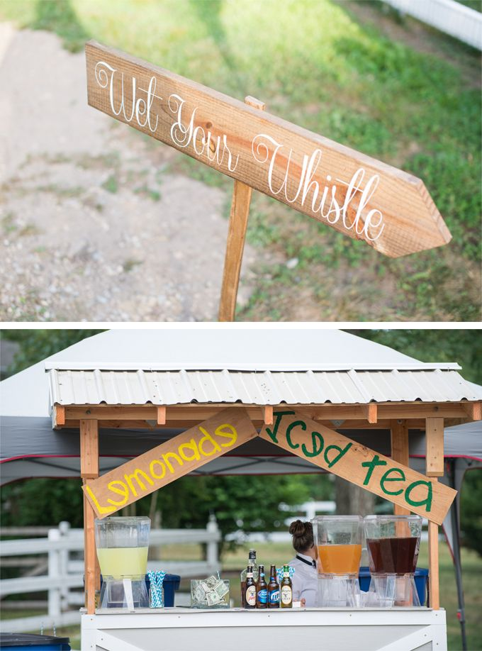 A custom built drink stand is a great touch for an outdoor wedding reception.