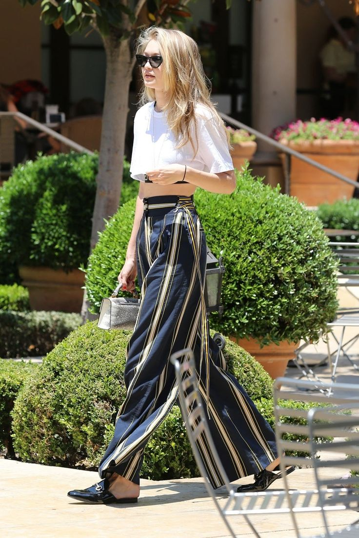 Wide leg pants, cropped tee, Gucci loafers.