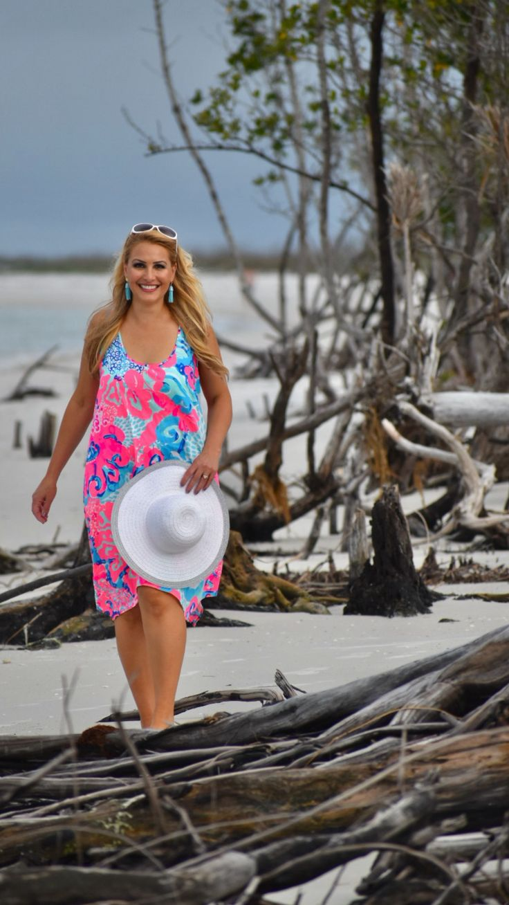 Street2BeachStyle - Pink Lilly Pulitzer Dress with Tassel Earrings and Beach Hat at Fort Desoto Beach, Florida. Lilly Pulitzer | Vacation Outfits | Lilly Pulitzer Dress | Spring Style | Summer Style | Lilly Pulitzer Outfits | Boho Style | Pink Outfits | Beach Hat INSTAGRAM: Jenn Truman @jtstjtst11 #lillypulitzer #beach #shiftdress #pinkdress #pink #resort365 #vacation #street2beachstyle #beachhat #tasselearrings #florida #summerstyle #springstyle