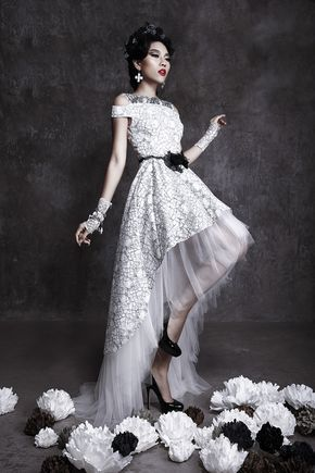 Mullet wedding dress in black and white floral lace. http://www.weddinginspirasi.com/2013/12/05/meera-meera-fall-2013-wedding-dresses/