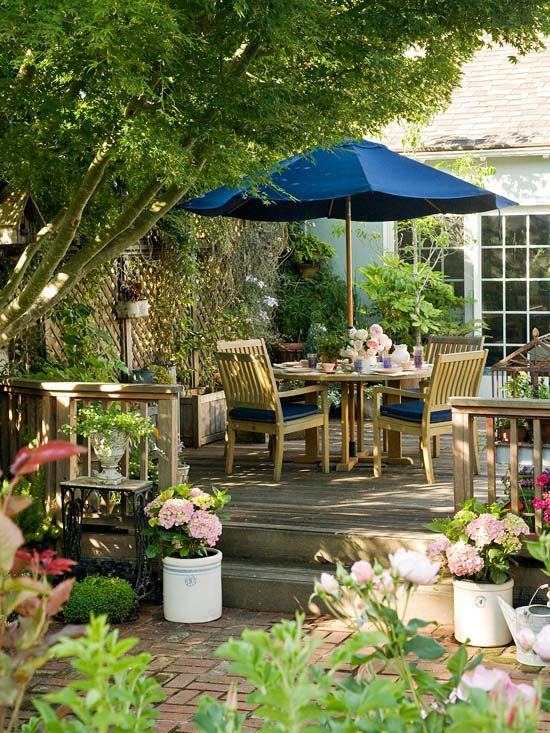 BHG - Incorporate a Tree - I love the lattice, it would look wonderful in our courtyard with jasmine running up it.