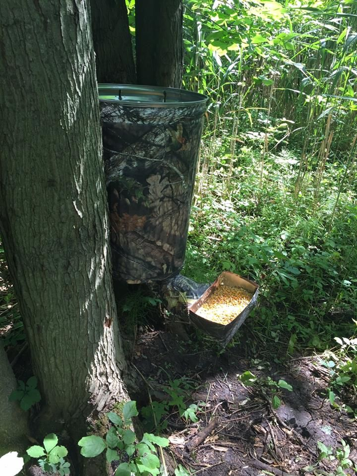 DIY Camo Deer Feeder using a garbage can and Mossy Oak Graphics camo vinyl rolls