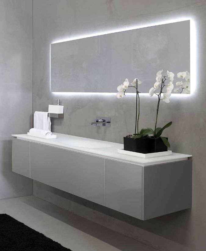 Modern Bathroom Mirror and Sink. Love the back lighting on the mirror