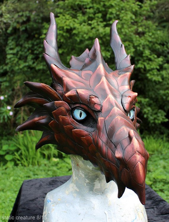 New, hand made leather dragon mask. It is fairly large and should fit most faces okay. It is made mostly from leather, with a resin base beneath the snout and forehead. Has glass eyes. Fleece padding inside, and an elastic straps to keep it to your face. Vision is through the mesh in front of the eyes, and is fairly limited. I would recommend getting some kind of mannequin head to have it rest on while not in use. Shipping is from New Zealand, and takes a couple of weeks to reach most…