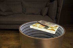 This tutorial will teach you how to make an Infinity Mirror Table. This table will light up objects that are placed on it, giving you a beautiful backdrop for your objects, but also force you to clean everything up before you leave the room, because the light will only goes off ones there is nothing left on the table. A one-way plexiglass mirror reflects LEDs into a two-sided plexiglass mirror, giving off the illusion of an infinite tunnel of lights.