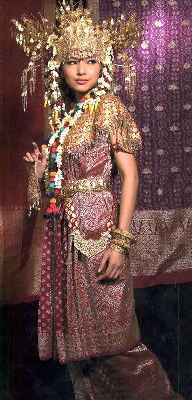 South Sumatran woman in Palembangese wedding costume ('aesan gede') featuring 'songket' - brocaded fabric.