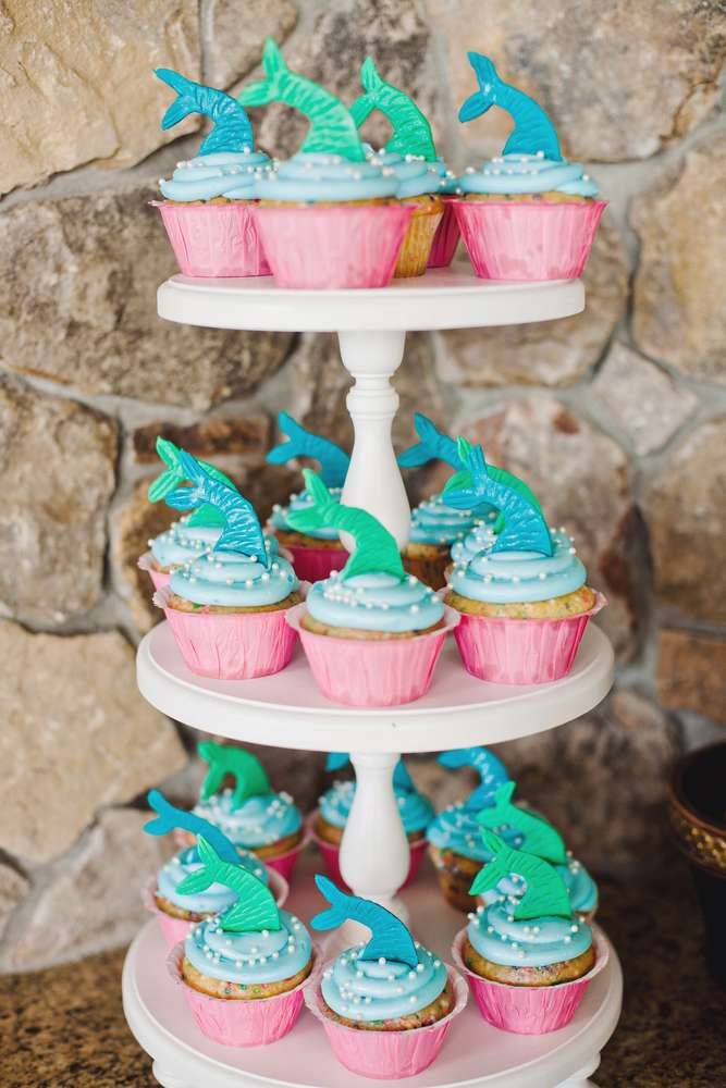 Tail topped cupcakes at a mermaid birthday party! See more party planning ideas at CatchMyParty.com!