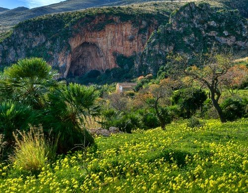 """#Spring and #autumn in #Sicily are perfect for the #trekking, because they aren't too hot. #Zingaro Natural Reserve is one of the most wanted destination for the trekking in Sicily. Surrounded by hill, mountainous and coastline paths where trekkers can discover stone beaches. Every point of the way can offer an exciting and unforgettable view. There are three difficulty levels, here you can see the #cave called """"dell'Uzzo"""". For more information have a look at bebtrapanilveliero.it"""