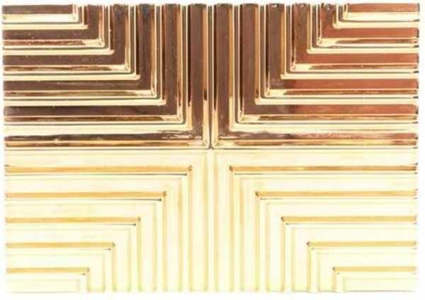 Chrissy Teigen wearing Lee Savage Cross Stack Clutch in Gold