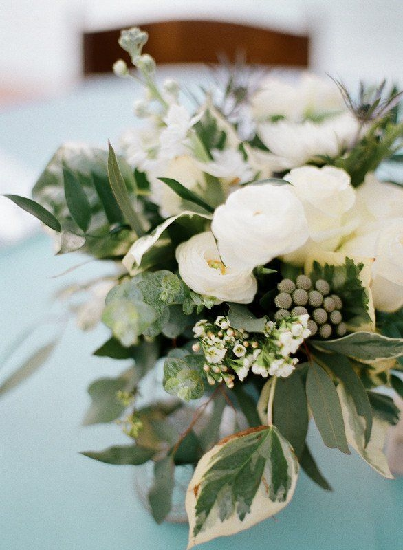 Elegant wedding centerpiece idea with white flowers and greenery