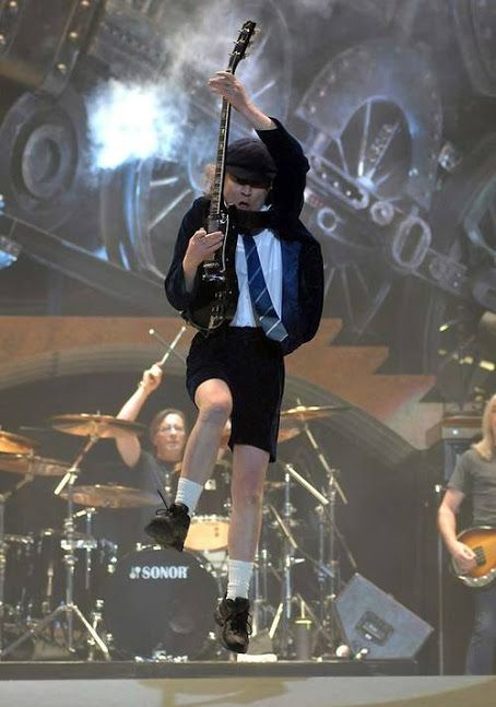 Angus McKinnon Young (born 31 March 1955) is a Scottish-born Australian guitarist best known as a co-founder, lead guitarist, and songwriter of the Australian hard rock band AC/DC.  Also known for his energetic performances, schoolboy-uniform stage outfits, and his own version of Chuck Berry's duckwalk.