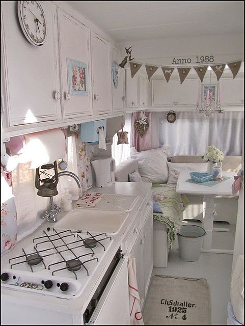 RV remodel - very cool. Like the burlap rug. too girly for my family - but like the white cabinets. before/after