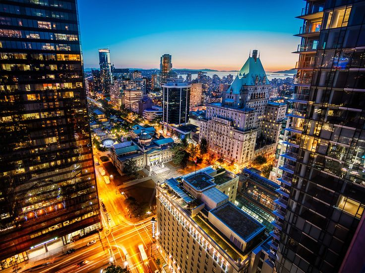 What a view! We spent the whole evening atop the hotel taking photos. Every angle was interesting, but I thought this one was perhaps the most enticing. If you end up getting a room there, be sure to ask for one that has a view of the water so that you can see something like this. I love Vancouver and can't wait to come back…  - Vancouver, Canada - Photo from #treyratcliff Trey Ratcliff at http://www.StuckInCustoms.com