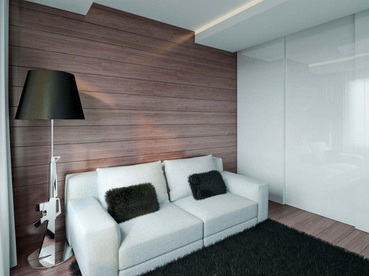 Projekt wnętrza na warszawskich Szczęśliwicach. Drewniana podłoga i okładzina ścienna z orzecha amerykańskiego, białe meble i designerska lampa w kształcie karabinu dają bardzo ciekawy i nowoczesny efekt.