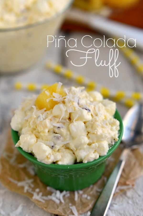 Bring that tropical feeling home with Pina Colada Fluff! An incredibly easy and delicious dessert salad!  MomOnTimeout.com | #recipe #salad #dessert #pineapple #coconut