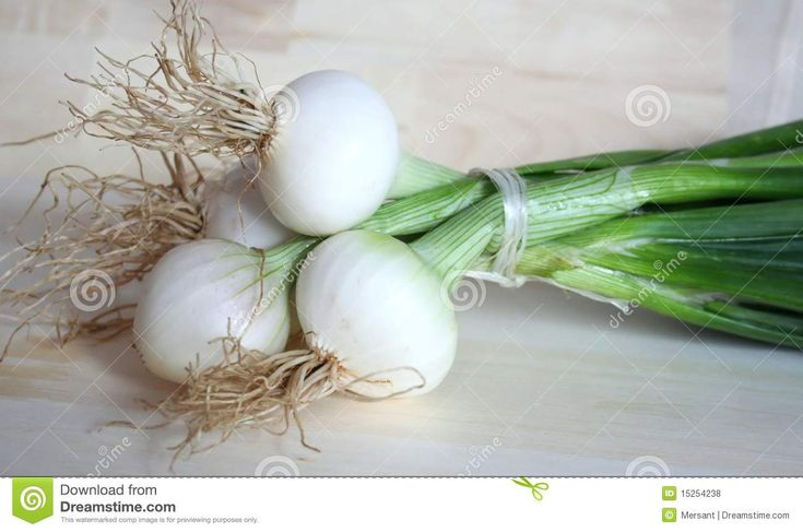 Some onions on a desk