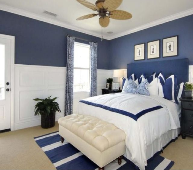 Crisp white duvet with navy ribbon, two-toned navy and white molding. Tasteful nautical - grown.