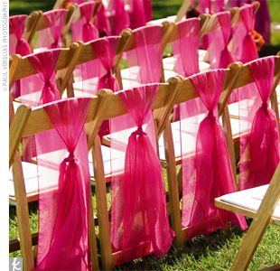 Tulle on wooden wedding chairs. Maybe just do for two chairs at bride and groom table at reception. Just to make them special :-)