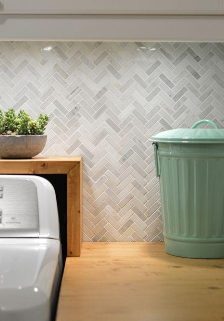 Grey herringbone tile (found here http://www.tileshop.com/product/hampton+small+herringbone.do)