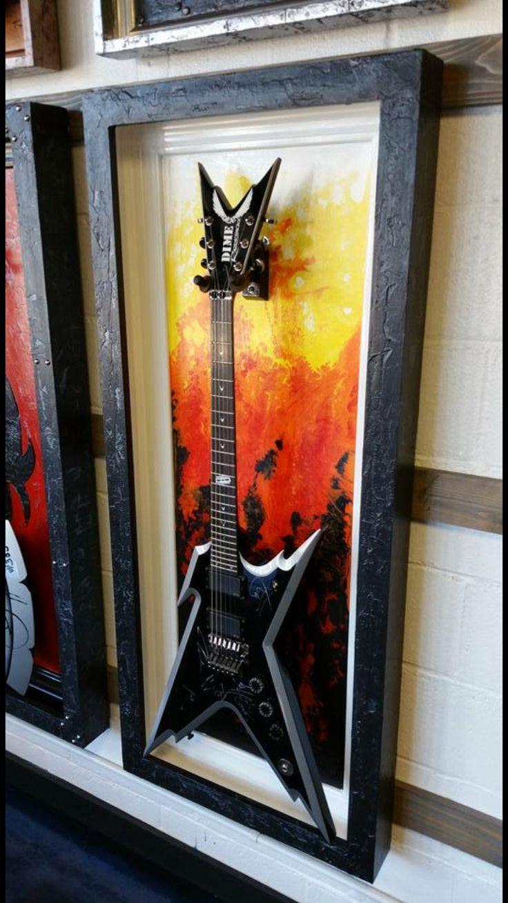 The #LakeOfFire by gFrames.com Guitar Display case frame